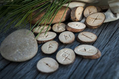 Wooden runes handmade. Wood runes handmade on an old wooden table. Esoteric subjects royalty free stock photography