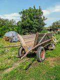 Rural wooden cart to load corn stock photos