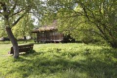 Wooden rural house in a green garden. Pirogovo, Ukraine. Stock Photos