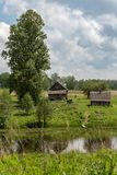 Wooden rural house on the lake shore in summer. stock images