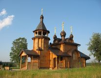 Wooden Russian church. Exterior of wooden Russian orthodox church in countryside with blue sky background Stock Images