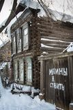 Wooden russian house. Wooden house in russian village at winter with inscription No Parking Stock Photo