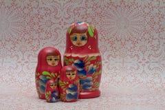 Wooden Russian Matryoshka Dolls. Four wooden nesting Matryoshka Dolls on lace background Royalty Free Stock Images