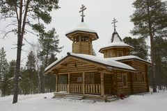 Wooden Russian Orthodox church in winter in Nellim, Lapland, Finland. Royalty Free Stock Image
