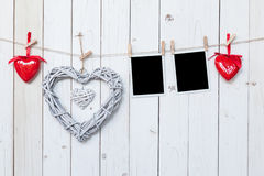 Wooden rustic decorative hearts and photo frame hanging on vinta Royalty Free Stock Photos