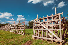 Wooden rustic fence and blue sky Royalty Free Stock Photo