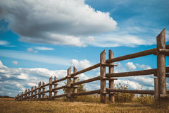 Wooden rustic fence in village and blue sky Stock Photo