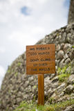 Wooden rustic sign at the Inca Ruins, Peru Stock Photo
