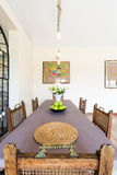 Wooden rustic table in dinning room Royalty Free Stock Photography