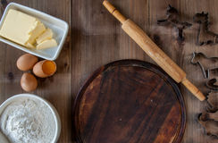 Wooden rustic table with everything you need for baking cookies Stock Photography