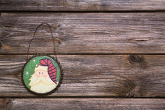 Wooden rustic and vintage christmas background with a hanging pa royalty free stock image
