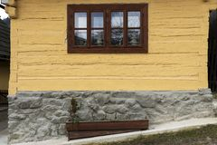 Wooden, rustic window in old cottage, Vlkolinec, Slovakia royalty free stock photo