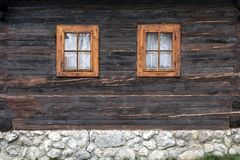 Wooden, rustic window in old cottage, Vlkolinec, Slovakia. Wooden, rustic window in cottage, Vlkolinec, Liptov, Slovakia Stock Photo