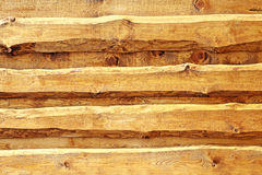 Wooden rustical board siding. Live edge board siding - spruce wood in oak rustical paint Stock Images