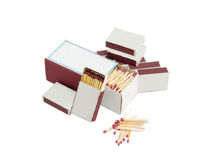 Wooden safety matches in several matchboxes of different sizes Stock Images