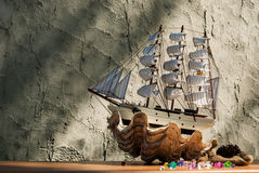 Wooden sail ship toy model with shells Stock Photography