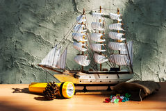 Wooden sail ship toy model with torch Royalty Free Stock Image