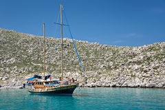Wooden sailboat, anchored in a cove Stock Image