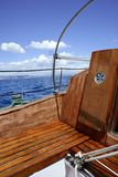 Wooden sailboat boat deck blue sky ocean sea Stock Image