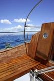 Wooden sailboat boat deck blue sky ocean sea. Wooden sailboat boat deck blue sky ocean mediterranean sea Stock Image