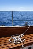 Wooden sailboat boat deck blue sky ocean sea Stock Images