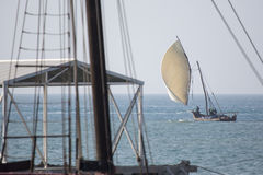 Wooden sailboat (dhow) on the clear turquoise water of Zanzibar Stock Photo