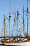 Wooden sailboat mast on blue sky Royalty Free Stock Photo