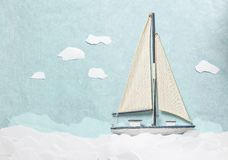 Yacht model with clouds made from papers shoot from above Royalty Free Stock Image