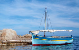 Wooden sailboat moored to the quay Stock Photos