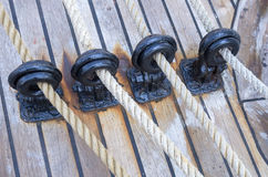Wooden sailboat pulleys and ropes. Detail royalty free stock photography
