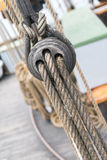 Wooden sailboat pulleys and ropes detail. Ancient wooden sailboat pulleys and ropes detail royalty free stock photo