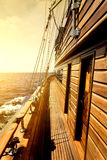 Wooden sailboat in sea Stock Images