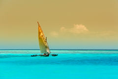 Wooden sailboat on water Stock Photo