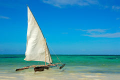 Wooden sailboat on water Royalty Free Stock Images