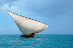 Wooden sailboat on water Stock Photography