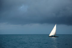 Wooden sailboat on water Royalty Free Stock Photo