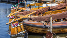 Wooden sailing ships in the harbor of Elburg Stock Images