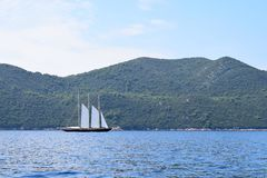 Wooden sailing yacht with three masts royalty free stock photo