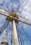 Wooden sailship rigging against blue sky with clouds Royalty Free Stock Photo