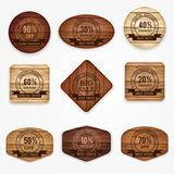 Wooden sale discount banners, stickers, labels collection . Set of various shapes wooden sign. royalty free stock images
