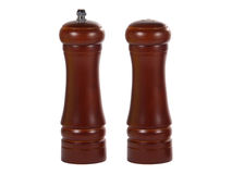 Wooden salt shaker and pepper mill grinder Stock Image