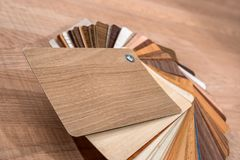 Wooden samples for floor laminate or furniture. In home or commercial building stock photos