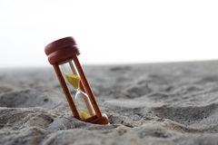 Wooden sand clock put on beach background Stock Photos