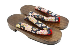 Wooden sandals over white Royalty Free Stock Image