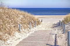 Wooden sandy path to the beach Royalty Free Stock Photos