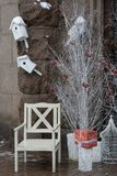Wooden santa chair near white trees and boxes with presents Stock Photography