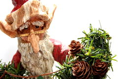 Wooden Santa Claus. A wooden carving of Santa Claus elf on white background Royalty Free Stock Photography