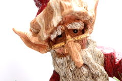 Wooden Santa Claus. A wooden carving of Santa Claus elf on white background Stock Image