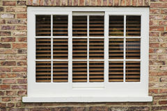 Wooden sash window. In a brick wall Stock Photography
