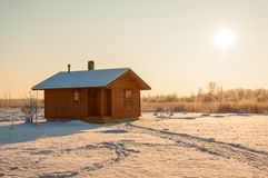 Wooden saun house in snow and frozen landscape Royalty Free Stock Photo